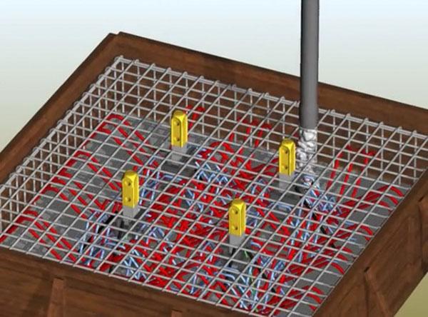 Bê tông được bơm vào chân đế tạo móng cần trục tháp vững chắc