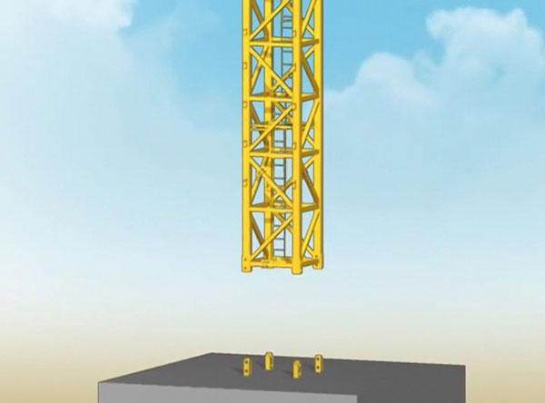 Đốt thân đầu tiên của cẩu tháp được đặt vào chân đế bằng xe cẩu